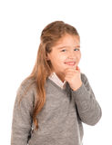 Mischievous little girl. Devising a plan dressed in school uniform Royalty Free Stock Photography