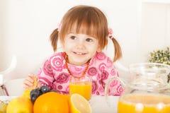 Mischievous little girl smiling Stock Image