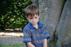 I like to prank, mischievous looking boy. Mischievous looking boy, he thinks about what prank  he can get up to do next Royalty Free Stock Photography