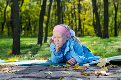 Mischievous small girl in a park Royalty Free Stock Images
