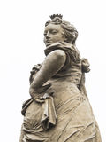 Mischievous woman statue. Cunning, mischievous and wily look of a woman statue Royalty Free Stock Photo