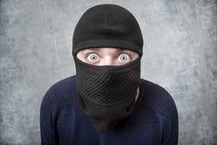 Misdadiger in balaclava stock afbeeldingen