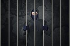 Misdadiger in gevangenis Royalty-vrije Stock Afbeeldingen