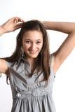 Mise de l'adolescence vers le haut de son cheveu Photographie stock