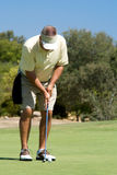 Mise du golfeur Photographie stock