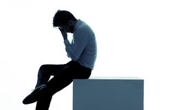 Miserable businessman lost his job. Miserable businessman lost his favourite job stock photography