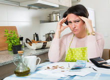 Miserable female counting money for payment Royalty Free Stock Photos