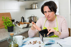 Miserable female counting money for payment Royalty Free Stock Photography