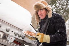 Miserable winter barbequer Royalty Free Stock Image