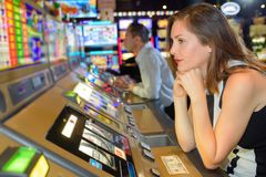 Miserable woman sat at arcade game. Miserable women sat at arcade game lose royalty free stock photos