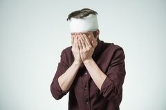 Man with bandage on his head Stock Image