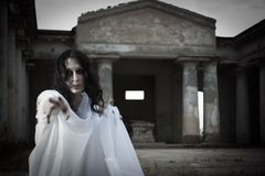 Misery. Pretty young gothic girl on  a cemetery Royalty Free Stock Photo