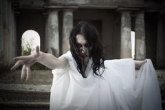 Misery. Pretty gothic girl on a cemetery Royalty Free Stock Photography