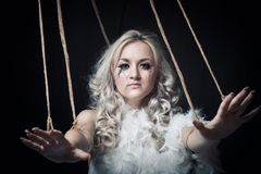 Misery. Pretty girl with ropes posing over dark background Royalty Free Stock Photography