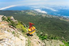 MISHOR, CRIMEA, UKRAINE - MAY 12. People travel. By rope way cab on top of Ai-Petri Mountain on May 12, 2013 in Mishor, Ukraine.Russia. This road has one of the Stock Photography