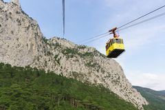 Mishor, Yalta, Crimea, Russia - September 14, 2018: Yellow cableway with tourists rises to the top of the picturesque AI-Petri. Mountain. The worlds longest stock images