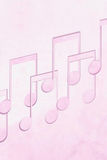 Misic notes on pink background Royalty Free Stock Image