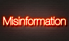 Misinformation neon sign on brick wall background. Misinformation neon sign on brick wall background vector illustration