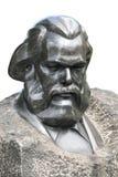 Mislukkingsmonument van Karl Marx op wit wordt geïsoleerd dat Stock Afbeelding