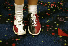 Mismatch. Bowling shoes.. one of each, diffrent sizes Stock Photos