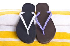 Mismatched Flip Flop on Yellow Striped Beach Towel Royalty Free Stock Images