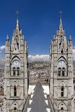 Mismatched Time. Tower of Basilica cathedral showing incorrect time with Panecillo in the background, Quito, Ecuador Royalty Free Stock Images