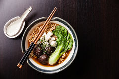 Miso Ramen Asian noodles with shiitake, tofu and pak choi. Cabbage in bowl on black table background Stock Photography