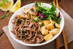 Miso and soba noodle soup w. Ith roasted tofu and mushrooms stock photos