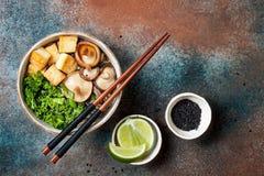 Miso and soba noodles soup with kale, shiitake mushrooms, roasted tofu. Stock Photo