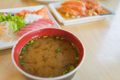 Miso soup and blur other salmon fish raw on table. Wood in restuarent Stock Image