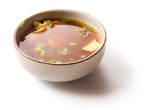 Miso soup with green onion in small dish over white. Background Royalty Free Stock Photo