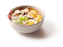 Miso soup with mushrooms in small dish. Over white background Stock Images