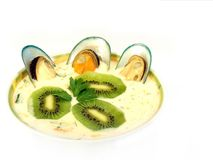 Miso soup with mussels. And kiwi fruit isolated on a white background Stock Photos