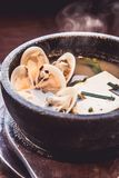 Miso Soup with tofu and shell, Japanese food. Cooking in Japanese Style. Japanese Cuisine Stock Photo