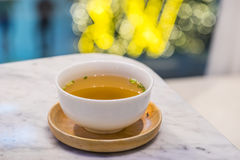 Miso soup. In a white bowl with bokeh background Stock Image