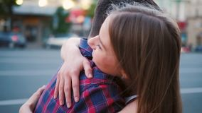 Miss affectionate sincere couple hug street. I missed you so much. Affectionate and sincere couple embrace. Love expression. Young man and woman hug in the stock video