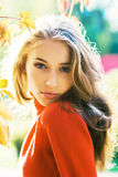 Miss autumn. Portrait of beautiful young woman in autumn park royalty free stock images