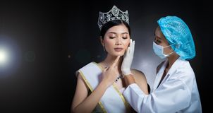 Miss Beauty Queen Pageant Contest with Diamond crown sash is che. Cked up by Beautician Doctor and recommend consult before Plastic Surgery, skin treatment royalty free stock photo
