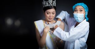Miss Beauty Queen Pageant Contest with Diamond crown sash is che. Cked up by Beautician Doctor and recommend consult before Plastic Surgery, skin treatment stock images
