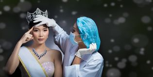 Miss Beauty Queen Pageant Contest with Diamond crown sash is che. Cked up by Beautician Doctor and recommend consult before Plastic Surgery, skin treatment royalty free stock image