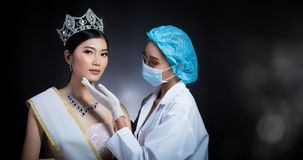 Miss Beauty Queen Pageant Contest with Diamond crown sash is che. Cked up by Beautician Doctor and recommend consult before Plastic Surgery, skin treatment royalty free stock photography