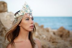 Miss beauty of the Red Sea in the Crown. Queen Beauty, handmade crown decorated with sea shells and pearls royalty free stock photography