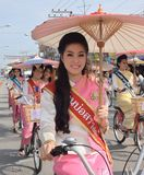 Miss Bosang umbrella Contest  with traditional dressed in parade ride bicycle . Royalty Free Stock Image