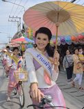 Miss Bosang umbrella Contest  with traditional dressed in parade ride bicycle . Royalty Free Stock Photos