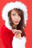 Miss Claus. Wearing Santa Hat Blowing kisses Royalty Free Stock Image