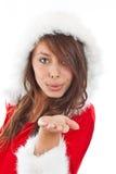 Miss Claus. Wearing Santa Hat Blowing kisses Royalty Free Stock Photos