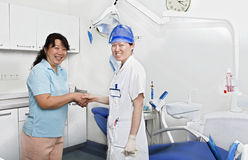 Miss dentist and her patient in clinic Stock Photos