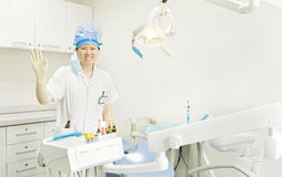 A miss dentist is waving hand Stock Photography