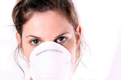 Miss Doctor. A young female doctor with her face mask on Royalty Free Stock Images