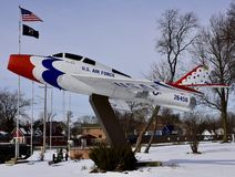 Miss We Go. This is a Winter picture of a F-84 known as Miss We Go on display on a pylon surrounded by snow at  VFW 26456 located in West Chicago, Illinois in Royalty Free Stock Images